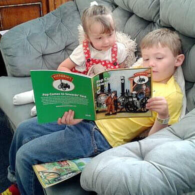 Happy Children reading Victoria's Torton Tales book.
